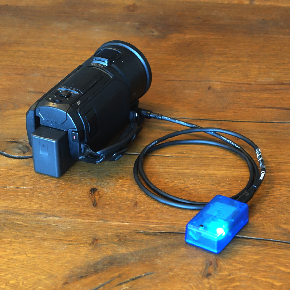Our video sync unit connected to a standard handheld video camera.