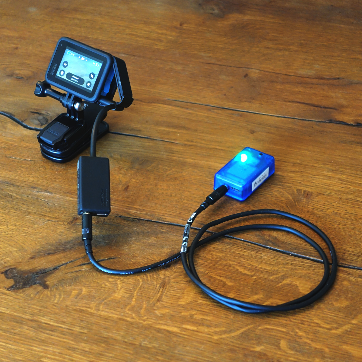 Our video sync unit connected to a GoPro camera.